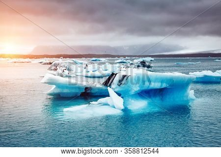 Majestic Jokulsarlon lagoon, large pieces of iceberg drifts in the ocean. Location famous place Vatnajokull national park, island Iceland, Europe. Nature wallpapers. Discover the beauty of earth.
