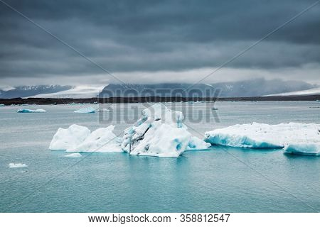 Exotic scene of Jokulsarlon lagoon, large pieces of iceberg drifts in the ocean. Location famous place Vatnajokull national park, island Iceland, Europe. Climate change. Explore the beauty of world.