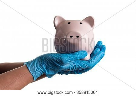 Doctor or Nurse Wearing Surgical Gloves Holding Piggy Bank Isolated on White.