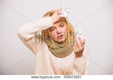 Nasal Spray Runny Nose Remedy. Woman Feels Badly Ill Sneezing. Girl In Scarf Hold Nasal Spray And Ti