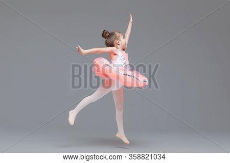 Cute Adorable Ballerina Little Girl In Pink Tutu Dance Practices Ballet Dancing