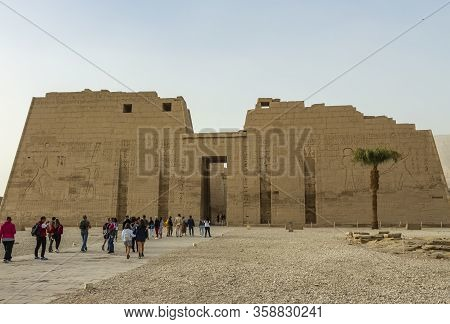 Medinet Habu, Luxor, Egypt - 26th Dec 2019: The First Pylon Of The Mortuary Temple Of Ramesses Iii I