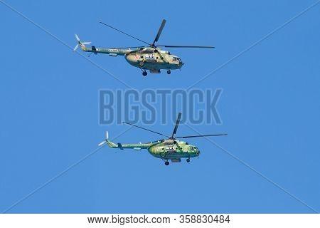 Saint Petersburg, Russia - July 25, 2019: Two Multi-purpose Helicopters Mi-8mt (rf-19066, Rf-19064)