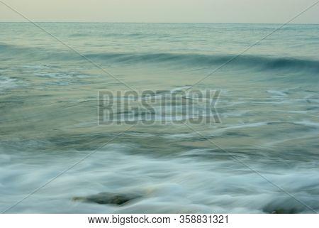 Turbulence Sea Water And Rock At Coastline