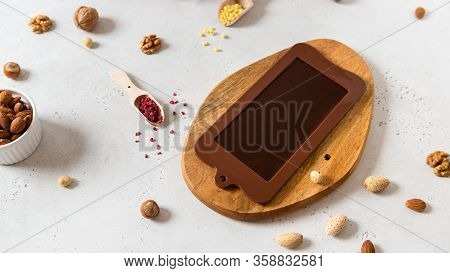 Homemade Chocolate In Mold. Chocolate Bar, Nuts, Freeze Dried Fruits On White Background Top View. C