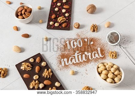 Raw Vegan Handmade Chocolate With Nuts. Chocolate Bars And Inscription 100 Natural Made Of Cocoa Pow
