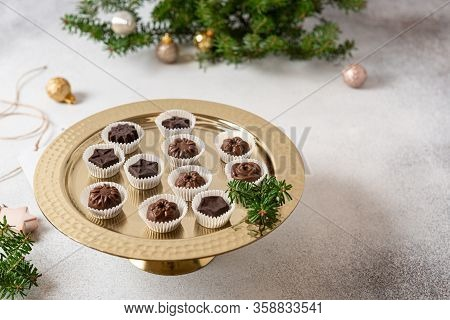 Homemade Dark And Milk Chocolate Pralines Candies On Golden Stand. Side View. Christmas Candies. Cho