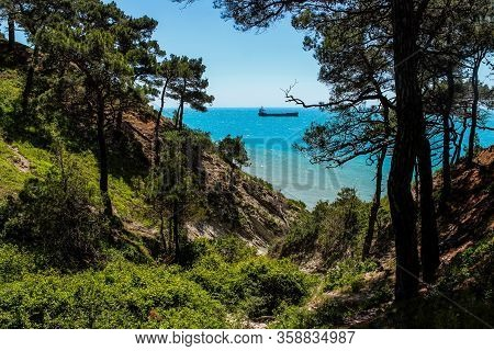 Hiking in picturesque places on the wild beach and camping. The outskirts of the resort of Gelendzhik and the neighboring city of Novorossiysk. Black sea coast