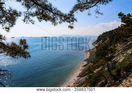 a trip to the wild beach and camping, the surroundings of the resort of Gelendzhik and a view of the rocks and cargo ships of the neighboring city of Novorossiysk. Black sea coast