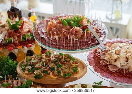 Delicious Snack, Appetizer On Party Or Picnic Time. Beautifully Decorated Catering Banquet Table Wit