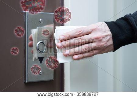 Closeup Male Hand Is Pressing Elevator Call Button Using Disposable Napkin. Virus Sars-cov-2 , 2019-
