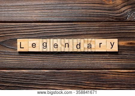Legendary Word Written On Wood Block. Legendary Text On Wooden Table For Your Desing, Top View Conce
