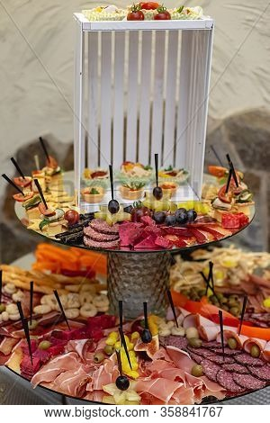 Variety Food On Table, Wine Snack Set, Olives, Cheese, Meats, Sliced Sausages And Other Appetizer. D