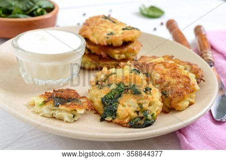 Pancakes With Cabbage And Spinach. Juicy Vegetable Cutlets On A Plate With Sour Cream. Diet Menu. Le