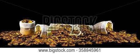 Stack Gold Coin And Bundles Of 100 Us Dollars Banknotes A Lot Of At Black Background, Money Stack Fo