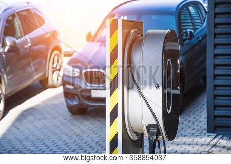 Charging An Electric Car Repair Shop Service Garage. Refueling For Cars E-mobility