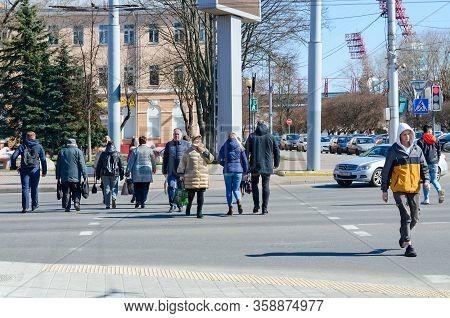 Gomel, Belarus - March 26, 2020: Unknown People Cross Street At Pedestrian Crossing. Absence Of Quar