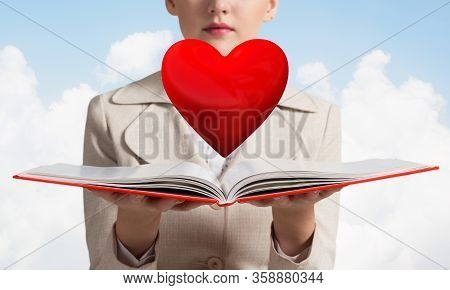 Beautiful Woman Showing Red Heart Above Opened Notebook. Love And Tenderness, Valentines Holiday And