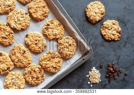 Homemade Oatmeal Cookies With Raisins On A Dark Background