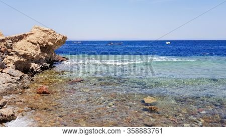 The Blue Hole Is A Popular Diving Spot In East Sinai. Sunny Beach Resort On The Red Sea In Dahab. A