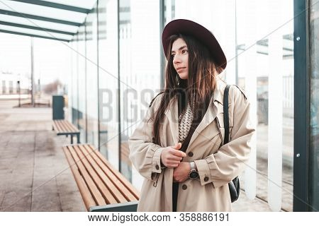 Lonely Girl Is Sad While Standing At A Glass City Stop