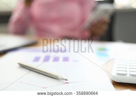 Table Financial Document With Pen And Calculator. Work With Numbers And Analysis Statistical Data. C