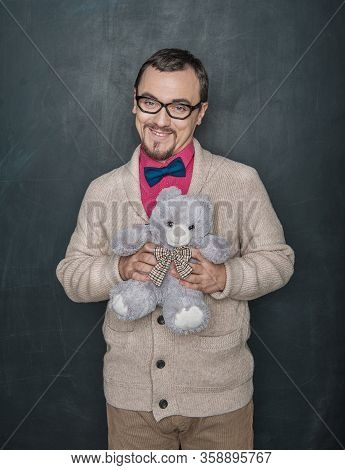 Funny Man In Retro Style With Teddy Bear Toy On Blackboard Background