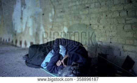 Homeless Teenager Sleeping On Street, Poverty, Indifferent Egoistic Society