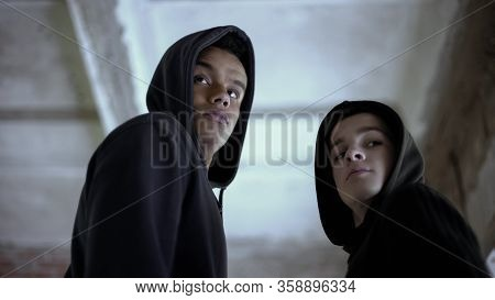 Two Boys Looking Back, Afraid To Be Caught For Committing Crime, Circumspect