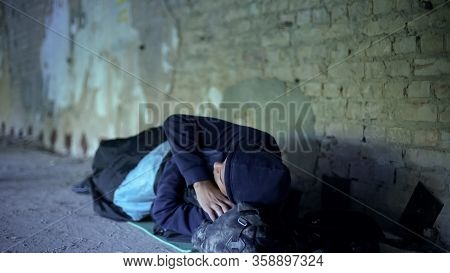 Homeless Young Man Sleeping On Street, Indifferent Egoistic Society, Poverty
