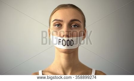 Thin Model With Taped Mouth, Concept Of Food Restriction And Anorexia, Diet