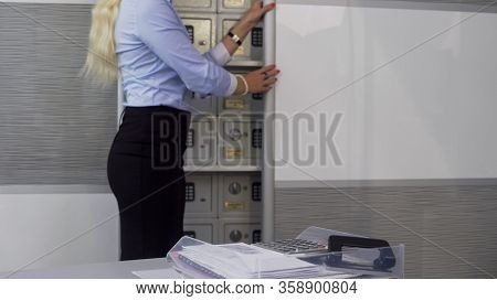 Bank Manager Showing Clients Deposit Boxes, Safe Storage Of Valuable Things