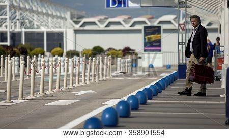 Business Man Waiting For Taxi Near Terminal, Chartered Flight, Transportation