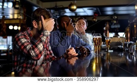 Deeply Upset About Soccer Team Losing Male Fans Watching Match In Pub, Facepalm