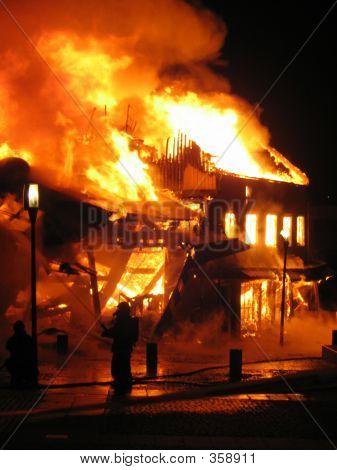 Firefighter Fighting Burning House.