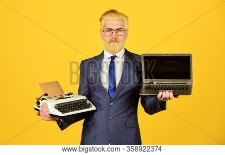 Learn It Easy Way. Successful Businessman Use Retro Typewriter And Modern Laptop. Man Dyed Beard Hai