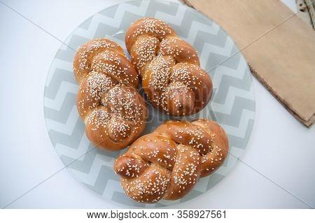 Challah Or Hala Is A Traditional Jewish Sweet Fresh Sabbath Bread Loaf, Fresh Bun On Cutting Board.