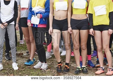 Young Female Atheletes Ready To Run. Race Start Line. Athleticism