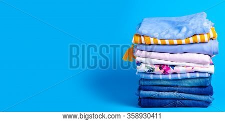 Stack Folded Colorful Clothing Summer, Jeans On Blue Background