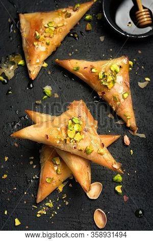 Arabe Phyllo Sweets. Feta Cheese Phyllo Triangles Pies With Honey And Pistachios. Selective Focus. C