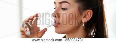 Beautiful Girl At Work Drinks Water From Glass. Periodic Replenishment Moisture Body. Woman Thirsty.