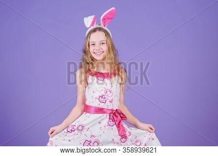 Adorable Cutie. Easter Bunny Is Symbol Of Easter. Small Girl In Bunny Headband For Easter Celebratio