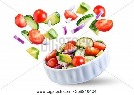 Cucumber Tomato Avocado Red Onion Salad On A White Isolated Background