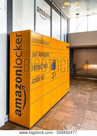 Amazon Locker In Shopping Mall, Orange Pick Up Point For Mail Order Goods With Amazon Brand Logo On