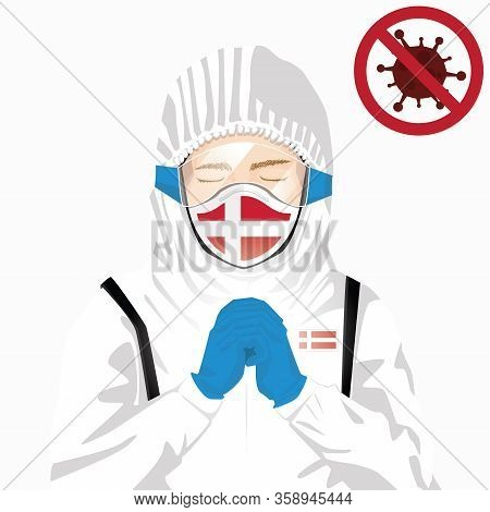 Covid-19 Or Coronavirus Concept. Danish Medical Staff Wearing Mask In Protective Clothing And Prayin