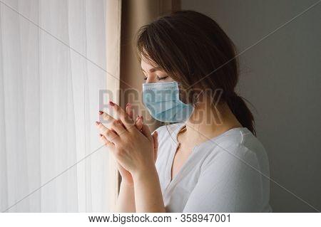 Coronavirus Covid-19. Woman Praying To God Requesting That The Coronavirus Covid 19 Not Spread Beyon