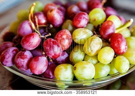 Fresh Green And Red Seedless Grapes On The Table, Organic Fruit Dessert Ready To Eat In A Selective