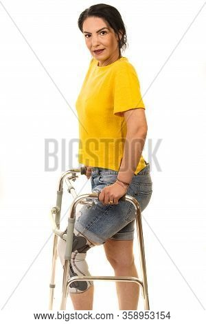 Smiling Woman With Walking Frame And Leg Orthosis Isolated On White Background