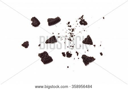 Oreo Biscuits With Crumbs  Isolated On White Background. It Is A Sandwich Cookies Filled With Chocol