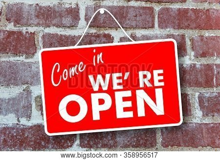 Come In We Re Open Text Sign On Brick Wall Background
